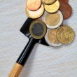 Stockfoto: COINS ON SHOVEL.
