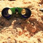 Binoculars on the sand. — Stock Photo