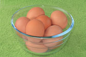 Chicken eggs in a glass bowl. — Stock Photo