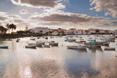 Coastal landscape of Lanzarote with fishing boats. — Stock Photo