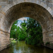 Under a Roman bridge — Stock Photo