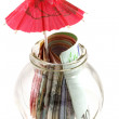 A glass jar contains money : paper currency with red umbrella — Stock Photo