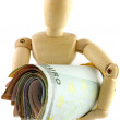A wooden doll holding a roll of money — Stock Photo #28557887