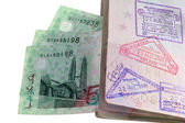 An entry and exit immigration stamp in the passport — Stock Photo