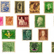 Vintage Grunge used postage stamps collection from different countries — Stock Photo #28673611