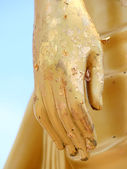Golden Hand of the Buddha statue — Stock Photo