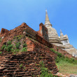 Foto de Stock  : Old and ruined stately Chedi at Wat PhrSi Sanphet Temple, Thailand