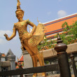 Golden statue of a Kinnara at Wat Phra Kaew, Bangkok, Thailand — Stock Photo