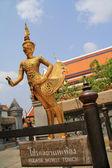 Golden statue of a Kinnara at Wat Phra Kaew, Bangkok, Thailand — Stock Photo