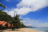A tropical bungalow along the beach — Stock Photo