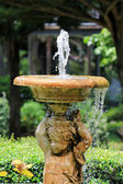 Bubbling Angel Sculpture Fountain in the garden — Stock Photo