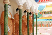 Mahayana-styled Buddhas along the Cloister at the Buddhist Temple, Penang Malaysia — Stock Photo