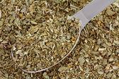 A spoon of dried Italian Seasoning mix — Stock Photo