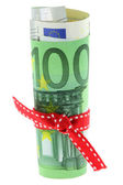 Rolled Euro banknote with a red ribbon bow — 图库照片