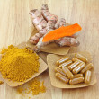 Stock Photo: Turmeric rhizome, powder and capsules