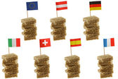 European flag toothpicks on Wholemeal bread — Stock Photo
