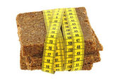 Measuring tape wrapping Whole grain fitness bread — Stock Photo