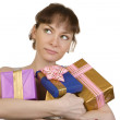 Dreaming girl with gifts — Stock Photo