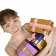 Happy girl with gifts — Stockfoto