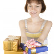 Girl giving gifts — Stock Photo
