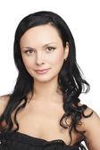 Dark hair young woman portrait, studio shot — Stock Photo