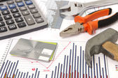 Housebuilding and renovation graphics and hammer and credit card — Stock Photo