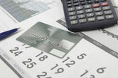 Bank card on calendar page — Stock Photo