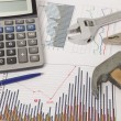 Stock Photo: Graphics with calculator and tools
