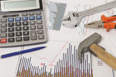 Graphics with calculator and tools — Stock Photo