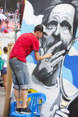 Graffity painter drawing a picture — Stock Photo