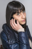 Young woman intent on a conversation on a cell phone — Stock Photo