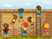 Niños en una pared de escalada — Vector de stock