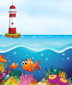 A light house, fishes and coral in sea — Stock Vector