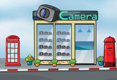 A camera store and letterbox — Stock Vector