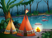 Traditional indian tents in the woods — Stock Vector