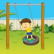 A boy swings on a wheel - Stock Vector