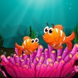 Two fishes above a pink coral — Stock Vector