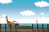 A docked boat and lighthouse — Stock Vector