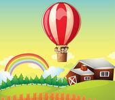 Kids in an air balloon and a house — Stock Vector