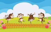 Monkeys playing in the garden — Stock Vector