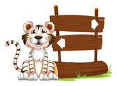 A tiger beside the signboard — Stock Vector