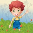A young boy in the garden — Stock Vector