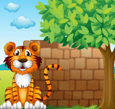 A tiger at the left side of a brick wall — Stock Vector