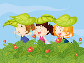 Three little kids playing in the garden — Stock Vector