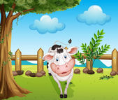 A cow inside the fence — Stock Vector