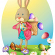 A bunny carrying a bag of Easter eggs — Stockvectorbeeld