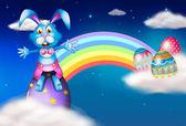 An easter bunny and eggs near the rainbow — Stock Vector