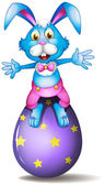 A rabbit above an easter egg — Stock Vector