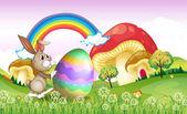 A bunny pushing an easter egg — Stock Vector