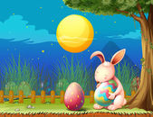 A bunny in the fence with two easter eggs — Stock Vector